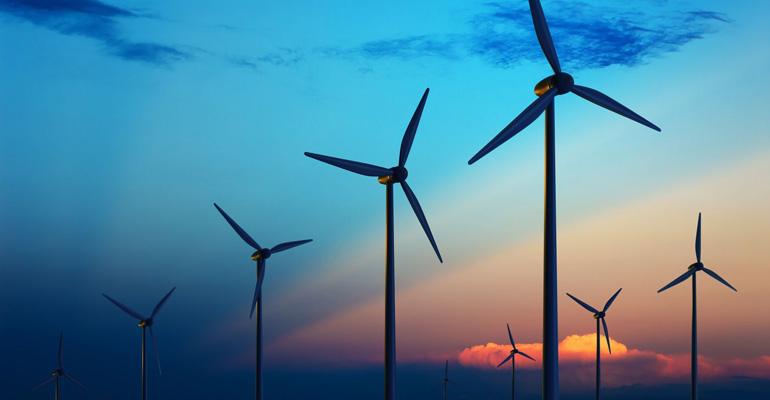 8170311 - wind turbine farm with rays of light at sunset